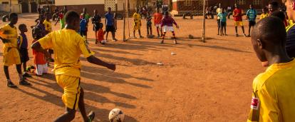 Students practice their football skills in Ghana.